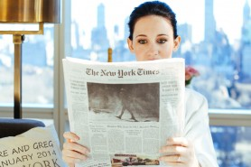 Elopement in NYC - The bride reading the New York Times at the Trump Hotel Suite
