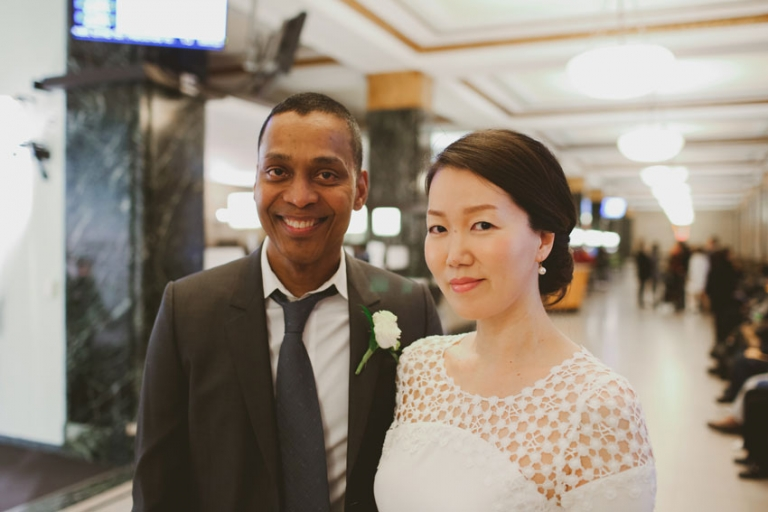 Multicultural couple getting married at NY City Hall