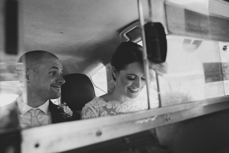 couple eloping yellow cab